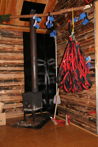 Harness are drying in one of the log cabins.